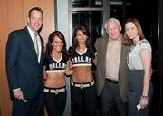Door prize winners Craig Scheef of Texas Security Bank, left, and Ronald Gafford pose with a couple of the Dallas Ice Girls and D'Ann Faught of the Dallas Stars.