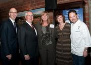 Event sponsors Chris Wallace of the Greater-Irving-Las Colinas Chamber of Commerce, Steve Good of Gardere Wynne and Kay Castro of Emirates Airlines posed with DBJ Publisher Tracy Merzi and host Chef Stephan Pyles.