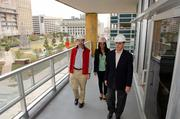 Forest City's Brian Ratner, Lashanda Daniels and Jim Truitt show off the work at the Continental Building.
