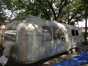 Boso is planning to cut a side out of an Airstream trailer to convert it into one of the site's three bars.