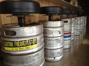 Old beer kegs have been re-imagined into bar stools.