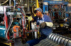 GM employee Laverne Johnson works in the body shop at the GM Arlington Assembly Plant. General Motors on Tuesday announced it will begin construction on a new $200 million stamping facility that will create approximately 180 jobs at the Arlington Assembly