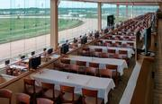 The dining tables will overlook the track at Lone Star Park.