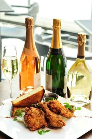 Max's Wine Dive's menu features comfort food favorites including chicken and champagne.