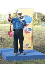 Bob Montgomery, Southwest Airlines' vice president of properties, holds a shovel that was used in the groundbreaking of their current home across the road in 1988.