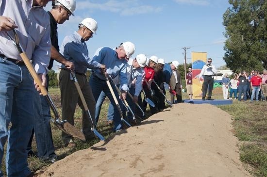 Southwest Airlines executives help turn the dirt Monday to break ground on the company's headquarters expansion.