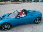 Staff writer Nicholas Sakelaris in the driver's seat with the Tesla Roadster's owner Scott Weber along for the ride.