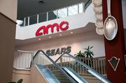 An AMC theater and a Sears store sit at the top of the escalator inside Valley View Center.