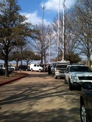 Media trucks sit outside AMR's Fort Worth headquarters while officials met with union leaders.