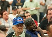 1974 Vought retiree Joe Silva and current employee Joe Lacy listen to UAW 848 press conference.