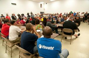 A full house of union workers listen as speakers talk about the possible loss of jobs at Triumph Aerostructures.