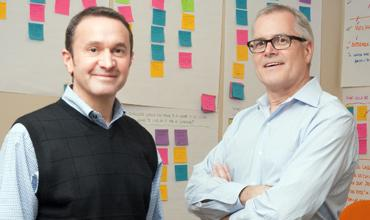 Larry Meltzer, at left, and Rob Martin, founders of MM2 Public Relations, stand in what they call the 'creative corner' of their Dallas offices, where they develop ideas for marketing campaigns.