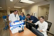 Drs. Brett Roth, from left, Elizabeth Fagan, Robert Bontreger and Chet Schrader work in the Baylor Carrollton emergency department. The department treats 35,000 patients each year.