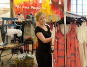 Lexie Mann browses the Free People clothing selection at Belk's McKinney store.