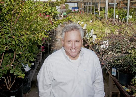 The green thumb: 'The consumer is king, all the time,' says Randy Roush, vice president of Berry Family of Nurseries, at a Lowe's in Southlake that sells Berry plant products.