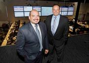 Bridger Group CEO Julio Rios and COO Jeremy Gamboa stand above the control room at their Farmers Branch office, where they can track the 190,000 barrels of crude oil Bridger moves across the United States every day via rail, truck and pipeline.