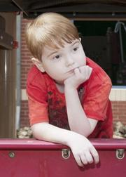Joshua Spencer, 8,  moved to the area with his mom to receive treatment at Children's Medical Center for Crohn's disease.
