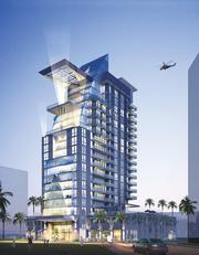 Humphreys & Partners Architects designed this 17-story tower with a heliport in Dubai.