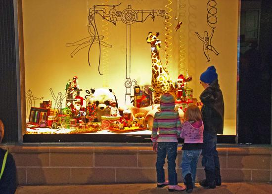Tis the season: Children marvel at Neiman Marcus' holiday displays during Saturday's City Lights event.