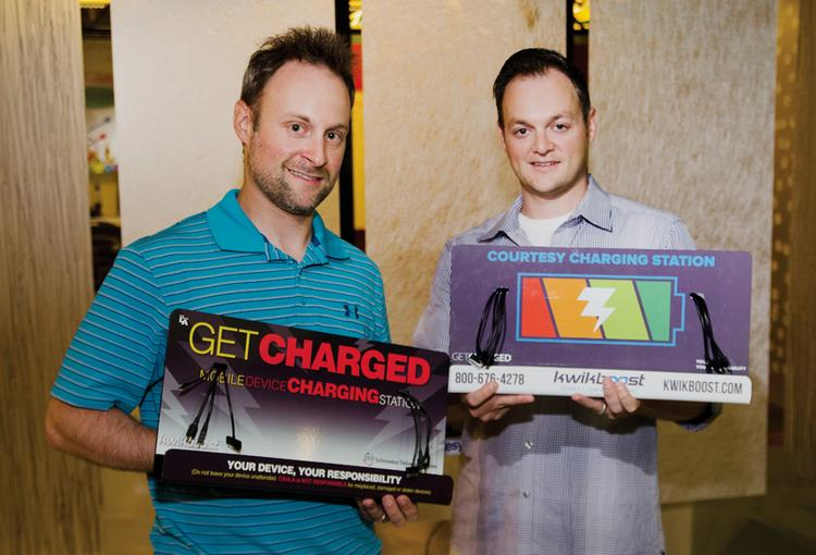Brothers Joe (left) and Paul Mecca with their KwikBoost charging stations.