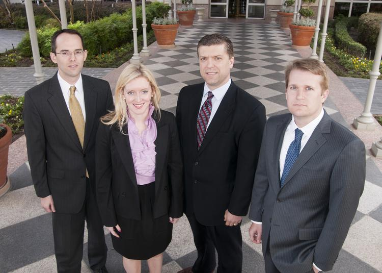 TRUSTED ADVISERS: From Stephens Inc., from left: Grant Jones, vice president of investment banking; Allie Atwood, investment banking associate; Marshall McKissack, managing director of investment banking; and Michael Miller, senior vice president, investment banking