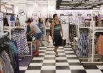 Traditional shops fight online giants with in-store experience