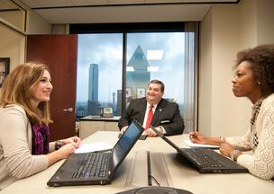 PwC North Texas Managing Partner Tom Codd meets with Marketing and Human Resources Leader Jeanne Jones, left, and Assurance and Human Resources Leader Aisha Washington, right. The company expects to add 400 people this year as part of its growth plan.