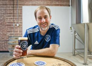 Michael Peticolas, founder of Peticolas Brewing draws/enjoys a pint of their signature brew Velvet Hammer at their Dallas micro-brewery.