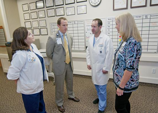 Joining the team: Nurse Manager Sue Wertheim, from left, talks with Director of Oncology Services Joe Brown, radiation oncologist Dr. Mark Engleman and Oncology Program Coordinator Emily Gentry at Baylor Regional Medical Center at Plano, one of six hospitals to take on the Sammons name.