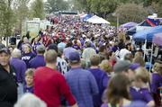 Fans file into Frog Alley before the sold-out game against OU Saturday at Amon G. Carter Stadium in Fort Worth. The Horned Frogs will play Dec. 29 in the Buffalo Wild Wings bowl for a $3.35 million payday for the school.