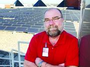 'You have to have a champion,' says Rick Hart, energy manager at the Dallas VA Medical Center, which took its large solar panel system online in 2008 after the federal government required the shift for Veterans Affairs facilities.
