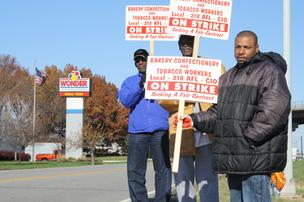 Striking workers picket at the Lenexa, Kan., Hostess plant.