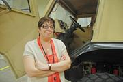 Program Manager Mary Lynne Lubinger proudly shows off one of Lockheed Martin's Common Vehicles, a stout vehicle used by troops for combat, reconnaissance and logistics. It comes in two models, one with an enclosed cab and the other with an open cockpit. It can reach a top speed of 80 mph.