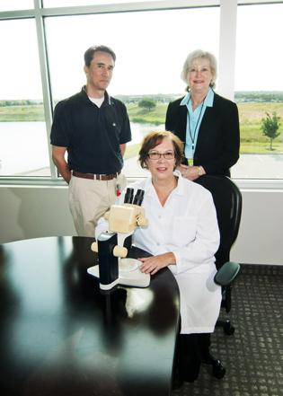 Starting up: DxUpClose CEO Cyndi Nickel, center, with Hubert Zajicek of the North Texas Enterprise Center for Technology, at left, and Jan Norton, Golden Seeds managing director. Nickel's medical device company received an $800,000 investment in the second quarter.