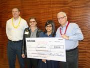 Dallas-based online education company Archipelago Learning held a national contest for students who have used its Study Island product. Peak Preparatory student Stephanie Cedillo won first place in the sixth through eighth grade category and received a $100 cash prize for her artwork. Pictured at the check presentation, from left, are Archipelago Learning CFO Mark Dubrow; Peak Preparatory teacher Danielle Dupuis; Cedillo; and Archipelago Learning CEO Tim McEwen.