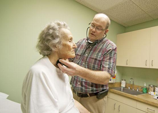 "Coordinated Care: Dr. Michael Marshall examines Adeline Rusk at the Methodist family health clinic in Cedar Hill. Methodist's clinics serve as ""medical homes"" for patients in the ACO."