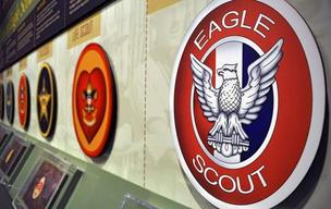 A wall at the Boy Scouts of America's National Scouting Museum in Irving shows off the organization's emblems, including the Eagle Scout, Boy Scout's highest rank.