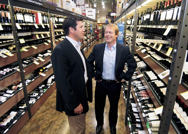 Darrell Hernandez of United Commercial Realty and Jack Breard of UCR Urban at Total Wine. The company's first Texas store is 30,000 square feet and is at 9350 N. Central Expwy.