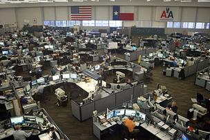 The American Airlines Systems Operations Center is a bevy of activity as the staff deals with the aftermath of a major thunder storm system that swept through North Texas.