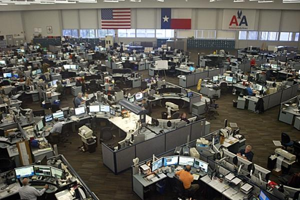 The Systems Operations Center at American Airlines is a busy place during severe weather such as what hit Dallas-Fort Worth on Tuesday, grounding the flights of American and other airlines.