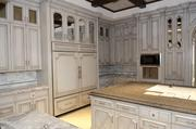 Growing demand for multimillion dollar homes is also spurred by the fact that a million dollars isn't what it used to be. In the Preston Hollow home at 10245 Strait Lane, custom finish kitchen cabinets are part of the luxe package.
