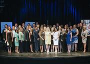 The 40 Under Forty honorees assemble onstage at the Granada Theater.