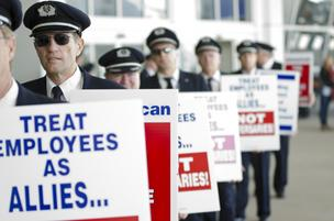 American Airlines pilots protest Thursday at Dallas/Fort Worth International Airport as their union negotiates with the carrier.