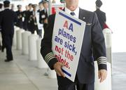 American Airlines pilots demonstrated in October outside Terminal D at Dallas/Fort Worth International Airport. A short time later the pilots' union and the airline came to a contract agreement and the pilots now have a seat in merger talks between AMR Corp. and US Airways Group.
