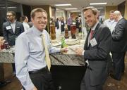 Michael Griffin and Dan Bowman network at The Foundry during the DBJ's After Hours event.