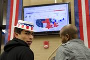 El Centro College student Oscar Gonzalez stands in front off an interactive map as results roll in during the school's presidential election watch party.