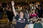 Brenda Vaughan cheers as election results roll in at the Democratic watch party at the Hyatt Regency.