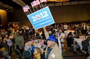 Gary Crosby celebrates as the electoral vote swings in favor of Obama during the Democratic watch party at the Hyatt Regency.