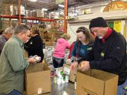 Kurz Group Inc. lend a hand at the North Texas Food Bank.