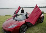 Neiman Marcus CEO Karen Katz checks out the $354,000 Neiman Marcus  edition McClaren 12C Spider, with its own McClaren luggage set.